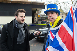 Bild journalist Philip Fabian speaks with Steve Bray, leader of the pro-EU group SODEM. Bray has built a reputation for disrupting news broadcasts from College Green by raising banners against the background as presenters interview various political figures in the temporary studios. London, January 14 2019.