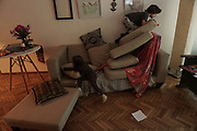 My children play on the couch of our living room during the government's call to 'stay at home'.