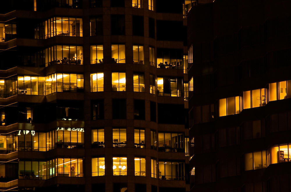 High Rise Windows at Night with Offices.