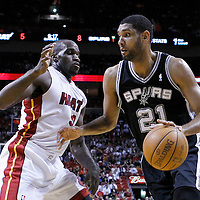17 January 2012: San Antonio Spurs center Tim Duncan (21) drives past Miami Heat center Joel Anthony (50) during the Miami Heat 120-98 victory over the San Antonio Spurs at the AmericanAirlines Arena, Miami, Florida, USA.