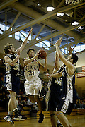 Bobby Long '09 drives in for a layup against three Lawrence defenders during the recent game in Darby Gymnasium.