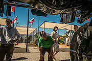 """2015/03/06 – Km 215 between Rosário and Buenos Aires, Argentina: Farmers look at """"a mosquito"""", used to apply agro-chemicals in agriculture fields like soy, on the Expo Agro fair, where producers have the change to see new lines of  agriculture machinery.  (Eduardo Leal)"""