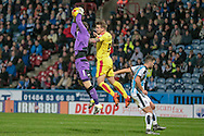 Jed Steer (Huddersfield Town) claims the ball ahead of Danny Ward (Rotherham United) during the Sky Bet Championship match between Huddersfield Town and Rotherham United at the John Smiths Stadium, Huddersfield, England on 15 December 2015. Photo by Mark P Doherty.
