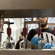 Tucson, AZ -- 09/28/2017<br /> <br /> Hamilton Distillers' assistant distiller Ramón Olivas bottles Whiskey Del Bac Clear with the help of volunteers. All volunteers sign up online, work a 4-5 hour shift, receive lunch and take home a bottle of whiskey.<br /> <br /> Hamilton Distillers, makers of Whiskey Del Bac, is the first craft distillery in Southern Arizona since prohibition. The company produces three distinct single malt whiskeys, including Whiskey Del Bac Dorado which is malted over mesquite.<br /> <br /> The distillery offers tours and tastings on Saturdays at 3 p.m. <br /> <br /> Photography by Jill Richards