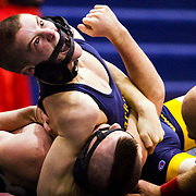 Clarkston High School wrestler  Conor Ryan, top, yells while pinning Mt. Morris wrestler Tyler Ballenger, bottom, in a tournament at Heritage High School.