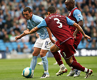 Photo: Paul Greenwood.<br />Manchester City v Aston Villa. The FA Barclays Premiership. 16/09/2007.<br />Man City's Elano (L) looks to shoot past the challenge of Wilfred Bouma and Nigel Reo-Coker