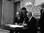 President Hillery Dissolves The Dáil. (R48)..1987..21.01.1987..01.21.1987..21st January 1987..At the request of An Taoiseach,Dr Garret Fitzgerald, President Patrick Hillery signed the Instrument of Dissolution to dissolve the Dáil and thus set in motion the general election...Picture shows the Bill being passed to Dr Fitzgerald so that he can add his signature to that of President Hillery.