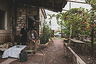 A group of veterans of the Karabakh War (1988-1994) who live in a village near Agdam prepare a table for guests. Agdam is located close to the line of contact with Azerbaijan in the disputed territory of Nagorno-Karabakh.<br /> <br /> (September 24, 2016)