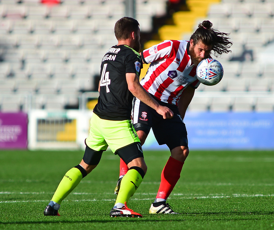 Lincoln City's Michael Bostwick vies for possession with Cambridge United's Gary Deegan<br /> <br /> Photographer Andrew Vaughan/CameraSport<br /> <br /> The EFL Sky Bet League Two - Lincoln City v Cambridge United - Saturday 14th October 2017 - Sincil Bank - Lincoln<br /> <br /> World Copyright © 2017 CameraSport. All rights reserved. 43 Linden Ave. Countesthorpe. Leicester. England. LE8 5PG - Tel: +44 (0) 116 277 4147 - admin@camerasport.com - www.camerasport.com
