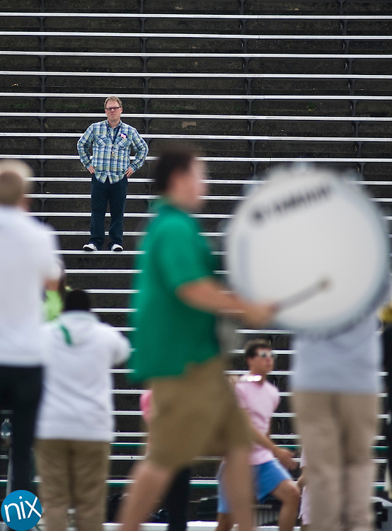 A.L. Brown marching band director Gordon Snyder watches with his band during a rehearsal at Kannapolis Memorial Stadium Wednesday afternoon. (Photo by James Nix)