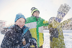 Children playing on snow field