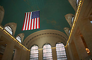 The ceiling of the rotunda at Grand Central Station with the huge American Flag, New York City