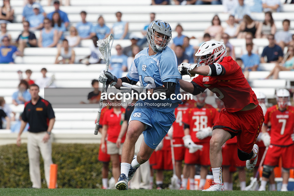 CHAPEL HILL, NC - MARCH 22: Chad Tutton #12 of the North Carolina Tar Heels during a game against the Maryland Terrapins on March 22, 2014 at Kenan Stadium in Chapel Hill, North Carolina. North Carolina won 11-8. (Photo by Peyton Williams/Inside Lacrosse)