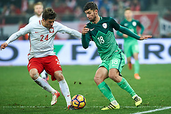 Wroclaw, Poland - 2016 November 14: (L) Bartosz Bereszynski of Poland fights for the ball with (R) Rok Kronaveter of Slovenia during Poland v Slovenia - International Friendly Soccer Match at Municipal Stadium on November 14, 2016 in Wroclaw, Poland.<br /> <br /> Adam Nurkiewicz declares that he has no rights to the image of people at the photographs of his authorship.<br /> <br /> Picture also available in RAW (NEF) or TIFF format on special request.<br /> <br /> Any editorial, commercial or promotional use requires written permission from the author of image.<br /> <br /> Mandatory credit:<br /> Photo by © Adam Nurkiewicz / Mediasport
