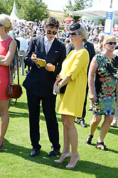 ZARA PHILLIPS and JAKE WARREN at the 3rd day of the 2013 Glorious Goodwood racing festival - Ladies day at Goodwood Racecourse, West Sussex on 1st August 2013.