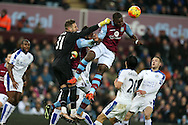Mark Bunn, the Aston Villa goalkeeper punches and Aston Villa's Jores Okore heads clear from a corner. Barclays Premier league match, Aston Villa v Leicester city at Villa Park in Birmingham, The Midlands on Saturday 16th January 2016.<br /> pic by Andrew Orchard, Andrew Orchard sports photography.