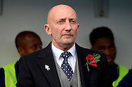Millwall Manager Ian Holloway looking on in the dugout before k/o.Skybet football league championship match , Millwall v Cardiff city at the Den in Millwall, London on Saturday 25th October 2014.<br /> pic by John Patrick Fletcher, Andrew Orchard sports photography.