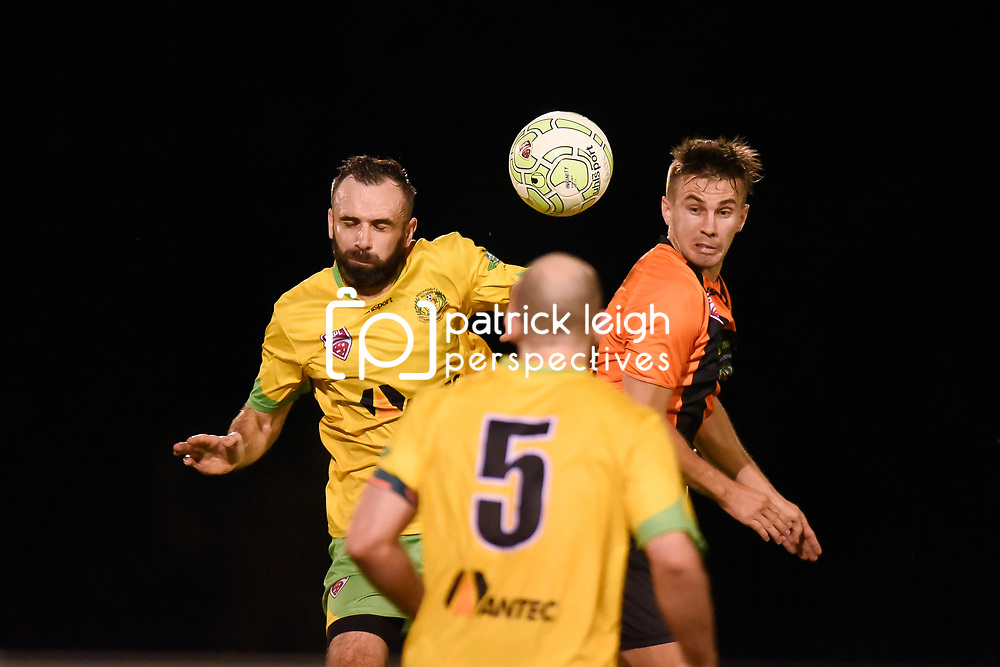 BRISBANE, AUSTRALIA - MARCH 17: Killian Flavin of Rochedale and Jarod Lancaster of Easts compete for the ball during the FQPL Senior Men's Round 7 match between Eastern Suburbs and Rochedale Rovers on March 17, 2018 in Brisbane, Australia. (Photo by Eastern Suburbs / Patrick Kearney)
