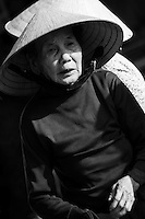 old woman wearing a conical hat.
