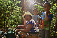 A Vietnamese mother and her children tend to their plot in the Clarkston Community Garden. Part of a documentary series on Clarkston, GA.  The most ethnically diverse square mile in America, there are over 70 nationalities that have sought refuge there since the 1980s.