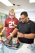 Tatnall School students make cheese in chemistry class on 24 Feb. 2016 Photograph by Jim Graham