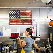 Hannah Cooper gathers drinks as a server in the Dixie Diner, in downtown Smithsburg, Maryland, on Tuesday, September 26, 2017. Smithsburg is a very different town than the southern part of the district that includes Potomac and Germantown. Originally a District that was mostly rural, but included towns like Frederick and Hagerstown, Maryland's 6th District was redistricted in 2011, combining rural northern Maryland regions with more affluent communities like near Washington D.C. turning the district from Republican to Democrat. <br />  <br /> CREDIT: John Boal for The Wall Street Journal<br /> GERRYMANDER