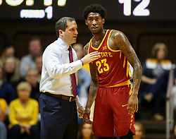 Feb 24, 2018; Morgantown, WV, USA; Iowa State Cyclones head coach Steve Prohm talks with Iowa State Cyclones forward Zoran Talley Jr. (23) during the first half against the West Virginia Mountaineers at WVU Coliseum. Mandatory Credit: Ben Queen-USA TODAY Sports
