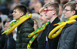 Derby County supporters wearing inflatable snakes around their necks