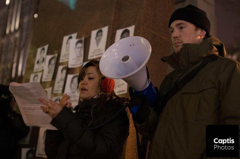 Vigil organizer, Eren Cervantes-Altamirano (Left), reads the names of the missing students. November 20, 2014.