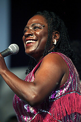 05 May 2012. New Orleans, Louisiana,  USA. .New Orleans Jazz and Heritage Festival. .Sharon Jones, soul and funk singer leads the Dap-Kings..Photo; Charlie Varley.