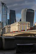 Buses on London Bridge and building in background, London, England, UK