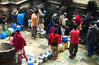 Patan Street Scene - Nepalese Water Tank.  Though it may appear almost medieval, Nepalese can be seen regularly queueing up to receive water from their local well.  Though you may imagine running water to be almost universal, in fact, long lines at the wells have been increasing as the government has regular power outs, which reduces the number of days that even water is available.