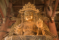 Asia, Japan, Honshu island, Nara, giant bronze Buddha in the Great Buddha Hall (Daibutsuden), within the Todaiji Temple complex.  Constructed in 752 and rebuilt in 1692, it is the largest wooden building in the world and a UNESCO World Heritage Site