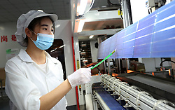 July 19, 2017 - Lianyungang, Lianyungang, China - Lianyungang, CHINA-July 19 2017: (EDITORIAL USE ONLY. CHINA OUT) A woman works at a silicon factory in Donghai County, Lianyungang, east China's Jiangsu Province, July 19th, 2017. Due to the development of science and technology, the silicon industry booms in Donghai County and the gross product of the 500 silicon factories reaches 30 billion yuan in the first half year of 2017. (Credit Image: © SIPA Asia via ZUMA Wire)