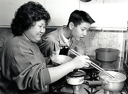 Vietnamese mother & son cooking, Carlton, Nottingham UK 1990