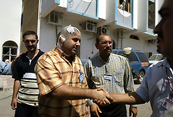 Kaiess Kesa, a security guard for the UN, visits the scene of the explosion at the Canal Hotel in Baghdad, Iraq on Aug. 21, 2003. Earlier in the week a cement truck packed with explosives detonated outside the offices of the UN headquarters in Baghdad, Iraq, killing 20 people and devastating the facility in an unprecedented suicide attack against the world body. At least 100 people were wounded.