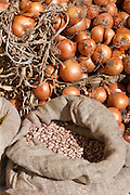 Onions and dried borlotti beans on sale in food market in Pienza, Tuscany, Italy