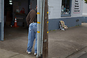 man outside garage, Half Moon Bay, California