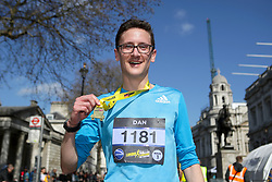 A competitor with his medal during the 2019 London Landmarks Half Marathon.