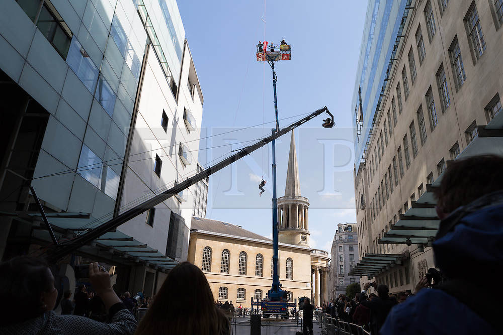 """© Licensed to London News Pictures. 10/06/2015. London, UK. Emma Willis takes part in a """"leap of faith"""" stunt at the new BBC Broadcasting House. Photo credit : Vickie Flores/LNP"""