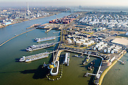 Nederland, Zuid-Holland, Rotterdam, 18-02-2015. Botlek, Geulhaven met Verkeerscentrale Rotterdam. Binnenvaarttankers liggen voor anker. Rechts LBC tank terminals en Odfjell, links Shell raffinaderije..<br /> Main harbor traffic station, moored inland tankers and oil terminals.<br /> luchtfoto (toeslag op standard tarieven);<br /> aerial photo (additional fee required);<br /> copyright foto/photo Siebe Swart