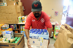 Premont, Texas, USA, Fire Fighter Ellie Robledo delivers food and water at the FEMA Dome after Hurricane Harvey displaced families, on Wednesday, August 30, 2017, at Tulsa-Midway High School in Corpus Christi. Photo by Gabe Hernandez/Corpus Christi Caller-Times/TNS/ABACAPRESS.COM