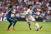 Real Madrid's player Marcelo and Celta de Vigo's player Fabian Ariel Orellana during a match of La Liga Santander at Santiago Bernabeu Stadium in Madrid. August 27, Spain. 2016. (ALTERPHOTOS/BorjaB.Hojas)