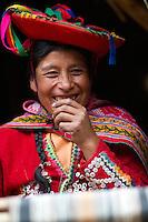 Native Peruvian woman weaving textiles. Sacred Valley, Peru.