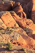 Morning's warm light on sandstone swirls, Hunt's Mesa, Monument Valley Navajo Tribal Park, Arizona