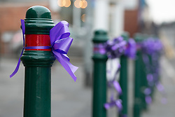 © Licensed to London News Pictures. 18/01/2015. Measham, Leicestershire, UK. The scene outside St Laurence's Church in the centre of Measham for the service of Kayleigh Haywood. Pictured, Kayleigh's favourite colour purple all along the high street. Photo credit : Dave Warren/LNP