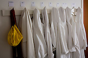 Garments hanging on a hook in the Sacristy (or vestry) of a local Cathoic church.
