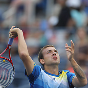Daniel Evans, Great Britain, in action against Tommy Robredo, Spain, during the Men's Singles competition at the US Open. Flushing, New York, USA. 31st August 2013. Photo Tim Clayton