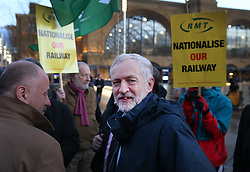 © Licensed to London News Pictures. 04/01/2016. London, UK. Labour leader Jeremy Corbyn (C) joins demonstrators at King's Cross station calling for lower rail fares. Photo credit: Peter Macdiarmid/LNP
