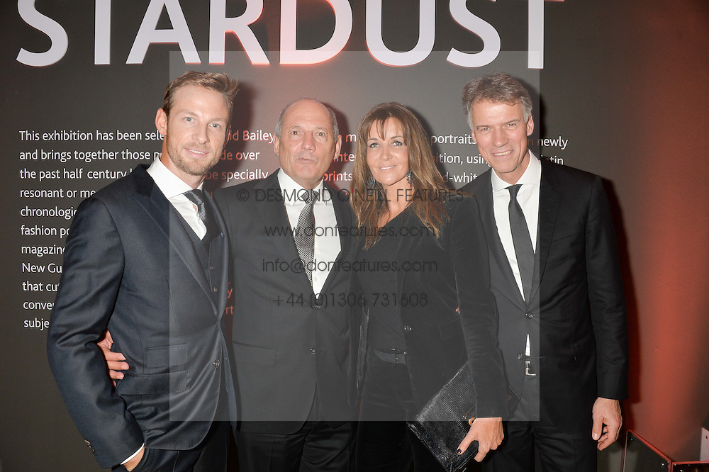 Left to right, JENSON BUTTON, RON DENNIS, CAROL WEATHERALL and CLAUS-DIETRICH LAHRS at a private view of photographs by David Bailey entitled 'Bailey's Stardust' at the National Portrait Gallery, St.Martin's Place, London on 3rd February 2014.